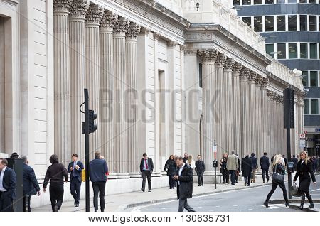LONDON, UK - OCTOBER 14, 2015. People walking by the Bank of England wall, London