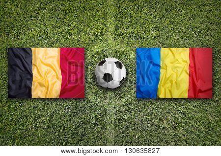 Belgium Vs. Romania Flags On Soccer Field