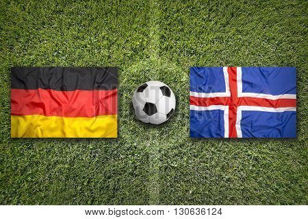 Germany Vs. Iceland Flags On Soccer Field