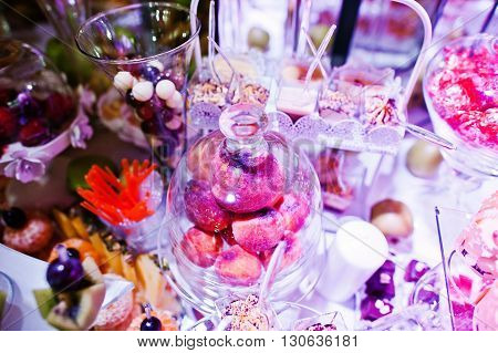 Elegance Wedding Reception Table With Food And Decor. Peach Under The Hood