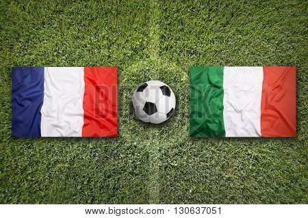France Vs. Italy Flags On Soccer Field