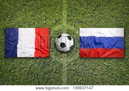 France Vs. Russia Flags On Soccer Field