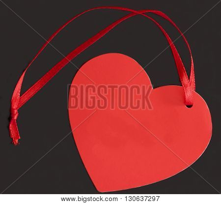 Red heart tag with ribbon used by retail traders.