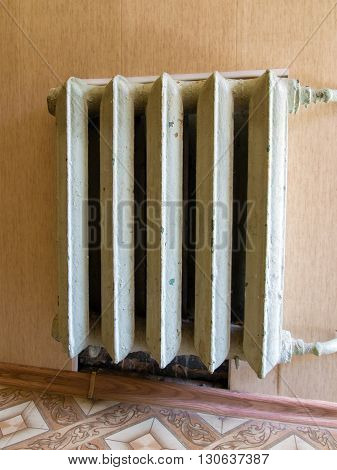 Old cast iron central heating battery on the wall