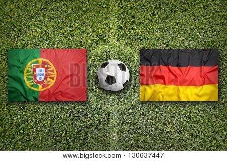 Portugal Vs. Germany Flags On Soccer Field
