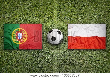Portugal Vs. Poland Flags On Soccer Field