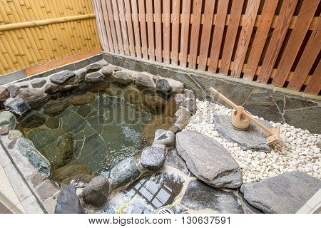 Outside Japanese hot bath made with stones