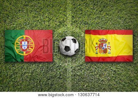 Portugal Vs. Spain Flags On Soccer Field