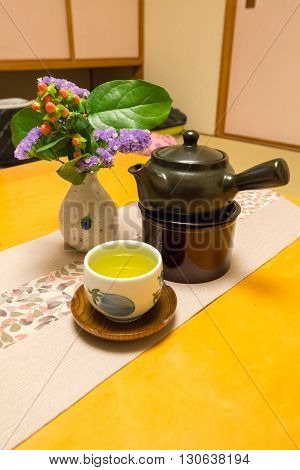 Japanese tea pot and cup on table