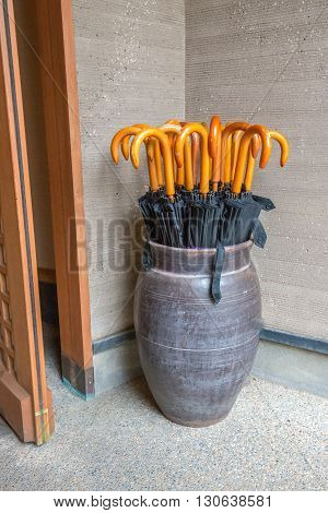 Collection of umbrellas in a large vase