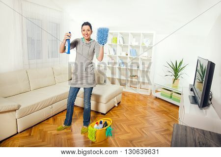 Woman holding a cleaning spray in hand