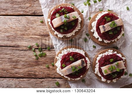 Scandinavian Sandwich With Herring, Beetroot And Cream Cheese. Horizontal Top View