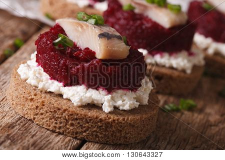 Smorrebrod With Herring, Beetroot And Cheese Close-up. Horizontal
