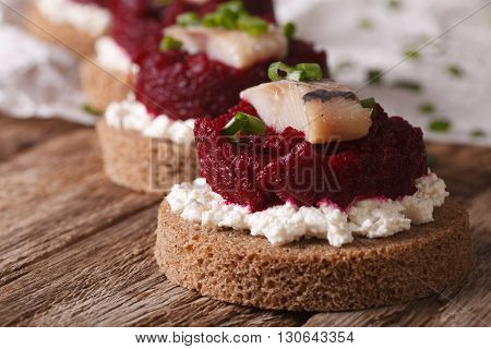 Sandwiches With Salty Herring, Beetroot And Cottage Cheese Close-up. Horizontal