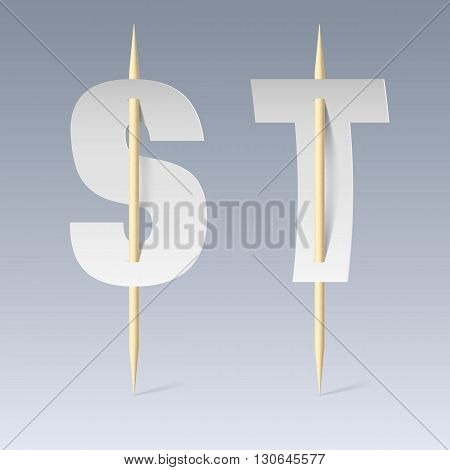 White paper cut font on toothpicks on grey background. S and T letters