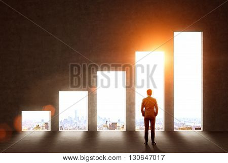 Success concept with businessman looking at wall with business chart and sunlit New York city view