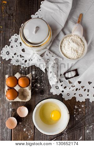 ingredients for a pie on a vintage wooden background