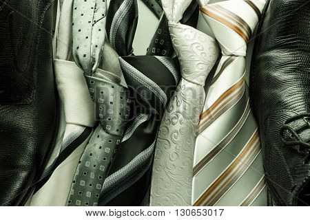 Set Of Colorful Men's Ties Isolated On Dark Background