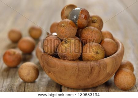 Fresh longan on a wooden background close up