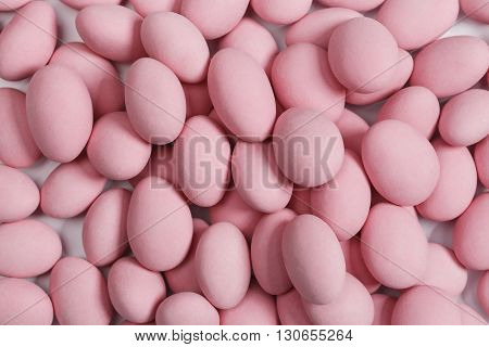 Large bunch of pink sweet candy background - studio shot