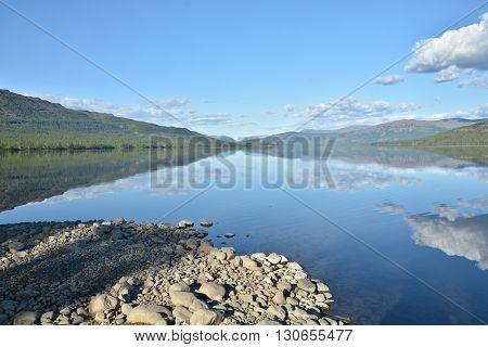 Lake Nakomaken on the Putorana plateau. Summer landscape mountain lake in Siberia.