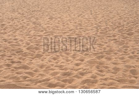 Close up sand texture background of a beach in the summer.