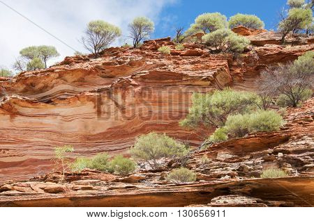 Murchison River gorge detail of tumblagooda red and white banded sandstone cliffs in Kalbarri National Park in Western Australia.