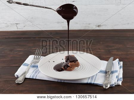 Melted Chocolate Pouring On Cookie