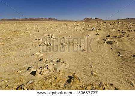 moon view of desert in Peru with sand, stones and salt on surface