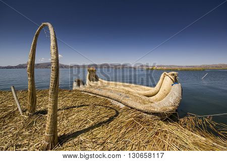 traditional boat of titicaca lake on water, view from floating island uros
