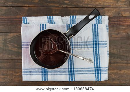 Pan Filled With Dark Chocolate With Silver Spoon