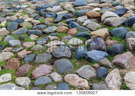 This is fragment of the ancient surviving square of the 16th century in the Russian north in Vologda paved with boulders.