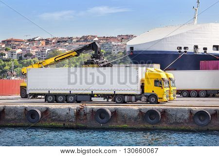Truck unloading in a port on the Sea