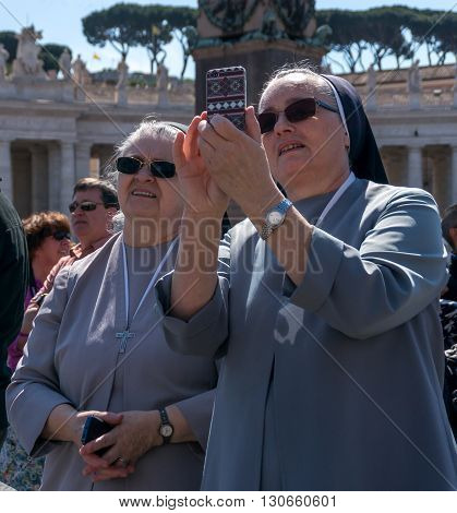 VATICAN CITY VATICAN - APRIL 10: Crowds of pilgrims gathered on April 10 2016 at Saint Peter's Square in Vatican. Thousands of people are praying together with Pope Francis every Sunday.
