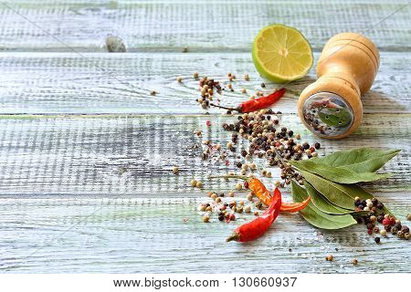 Spices, salt, lime on a wooden table with space