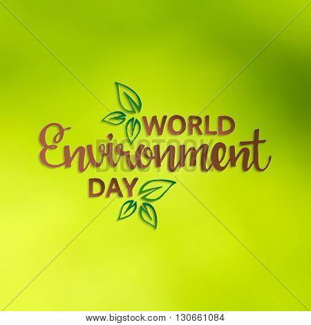World environment day. Handwritten lettering. Modern Calligraphy. Vector lettering on green blurred background. World environment day hand drawn lettering for your design