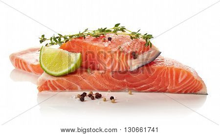 Fresh Raw Salmon Fillet With Lime, Thyme, Pepper And Salt Isolated On White