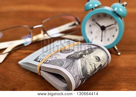 Dollar, Glasses  And Alarm Clock
