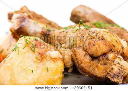 Delicious eastern baked meat mix with garnish. Served with chicken eggs and fresh vegetables. Macro. Photo can be used as a whole background.