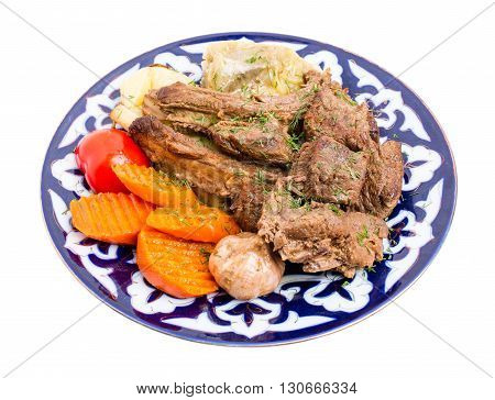Delicious baked lamb meat wit stewed vegetable mix as a carrot and cabbage in eastern style. Isolated on a white background.
