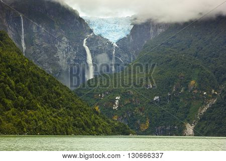 scenic view on glacier ventisquero calgante with waterfall and lake in chilean patagonia on the road Carretera austral
