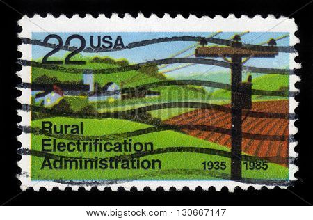 USA -CIRCA 1985: A stamp printed in United States of America shows Electrified Farm, Rural Electrification Administration, Circa 1985