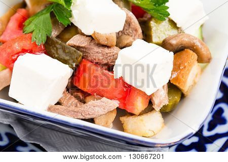 Delicious salad with veal tongue and champignons. Macro. Photo can be used as a whole background.