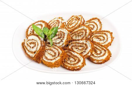 Delicious swiss roll with cream cheese and poppy seeds. Isolated on a white background.