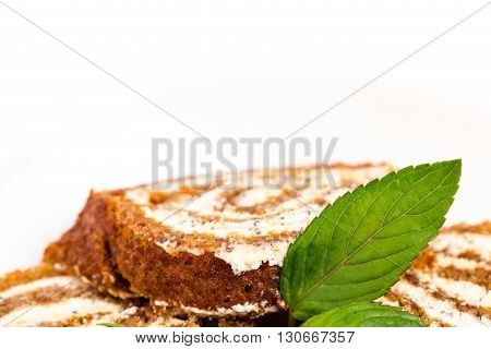 Delicious swiss roll with cream cheese and poppy seeds. Macro. Photo can be used as a whole background.