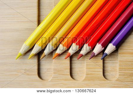 Color spectrum palette on wooden table background