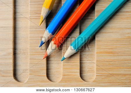 Four Color pencil composition still life with wooden background