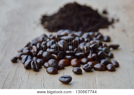 coffee bean and powder on wooden board