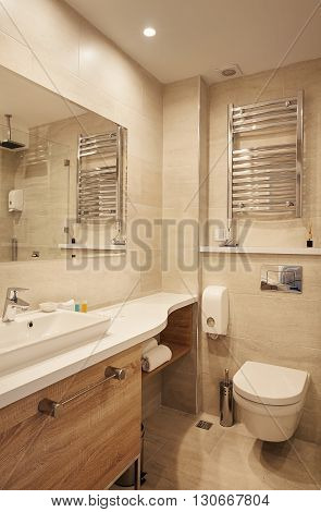 Interior of a modern hotel bathroom, illumination and design details.
