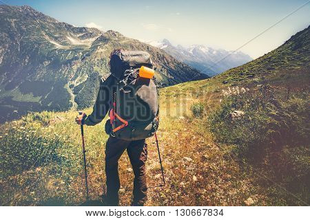 Traveler Man with backpack mountaineering Travel Lifestyle concept rocky mountains on background adventure vacations outdoor
